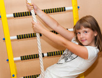Girl and ladder. Teen girl near sport ladder at home sport complex Royalty Free Stock Image