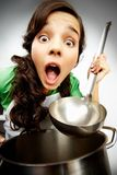 Girl with a ladle Stock Images