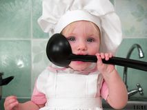Girl with ladle Royalty Free Stock Photos