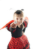 Girl in ladybug costume on white background Stock Image
