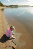 The girl at lake. The girl at wood lake in the autumn royalty free stock photos