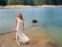 Girl by the lake. Girl in white by the lake Royalty Free Stock Photography