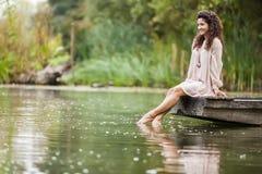 Girl on the lake Royalty Free Stock Image