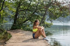 Girl by the lake Royalty Free Stock Images