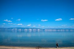 Girl on the lake Baikal shoreline