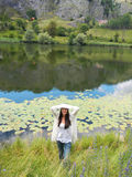 Girl by the lake Stock Photography