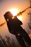 Girl at the lake at sunset Royalty Free Stock Photography