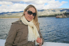 Girl by lake Tahoe in winter Stock Images