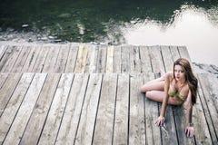 GIrl on lake wearing monokini. Royalty Free Stock Photo