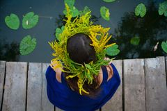 Girl by the lake with a wreath on head.  Royalty Free Stock Photography