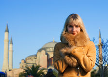 Girl in lambskin coat Stock Image