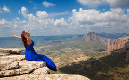 Girl and landscape. Girl with open arms to the sky royalty free stock image