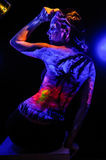 Girl with landscape bodyart in blacklight Stock Photo