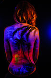 Girl with landscape bodyart in blacklight Stock Photos