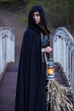 Girl with a lantern on the bridge Stock Photo