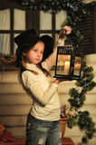 Girl with lantern Stock Images