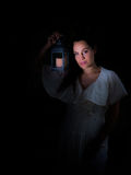 Girl with lantern. In & x28;Model portrait& x29; Dark background Royalty Free Stock Photography