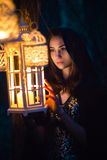 Girl with a lantern at night in the forest Stock Photography