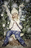 Girl with lantern and snow falling down Royalty Free Stock Photos