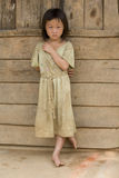 Girl of Laos in dirty clothes Stock Images
