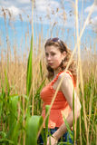 The girl in the lap of nature. Against the backdrop of the beautiful blue sky, the girl in the lap of nature Royalty Free Stock Photography