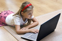 Girl and laptop stock images