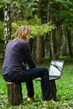 A girl with a laptop Royalty Free Stock Photo