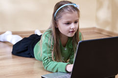 Girl and laptop royalty free stock image