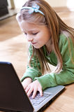 Girl and laptop Royalty Free Stock Photography