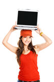 Girl with a laptop. Beautiful young girl showing something on a laptop, isolated on white royalty free stock image