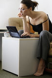 Girl with laptop. Girl surfing the internet on her laptop stock images