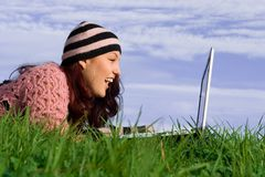 Girl on laptop royalty free stock photo