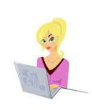 Girl and a laptop. Beautiful girl wearing glasses types on a laptop Stock Photography