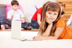 Girl with laptop beside Stock Photo