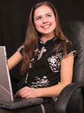 Girl with a laptop Stock Photography