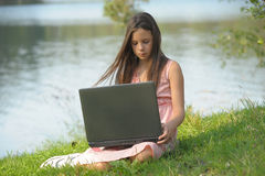 Girl with a laptop Royalty Free Stock Images