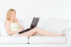 Girl with Laptop. Cute girl with laptop look something interesting Stock Images