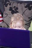 Girl with laptop Stock Photos