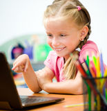 Girl with in the laptop. Girl Shows in the laptop screen royalty free stock photos