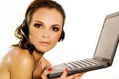 Girl with laptop. Beautiful brunette girl with a laptop on white background stock photos