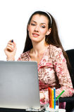 Girl and laptop. A beautiful girl working in a laptop stock photography
