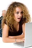Girl And Laptop. A young pretty woman with laptop computer on white background royalty free stock photography