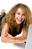Girl And Laptop. A girl with big smile using a laptop royalty free stock photo