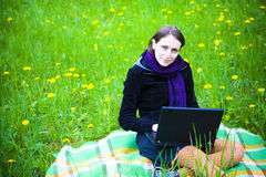 Girl with laptop royalty free stock photography