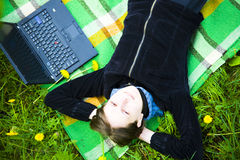 Girl with laptop. Relaxing outdoors in spring royalty free stock images