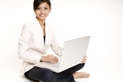 Girl With Laptop 6. A smiling cute asian businesswoman sits on floor with computer Stock Photos