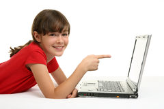 Girl with laptop. Young girl using laptop isolated on white Royalty Free Stock Image