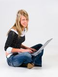 Girl with laptop. In studio. Withe background royalty free stock photos