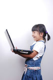 Girl with laptop. Little girl using laptop isolated on white Royalty Free Stock Photos