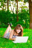 The girl with a laptop. Thinking Stock Images